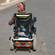 disabled man in an electric wheelchair