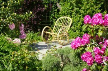 wicker rocking chair in secluded garden
