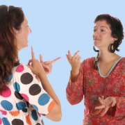 Two deaf women talking in sign language