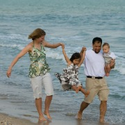 Family at the seaside splashing in the sea