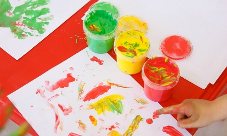 child finger painting