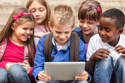 group of children around a tablet or ipad