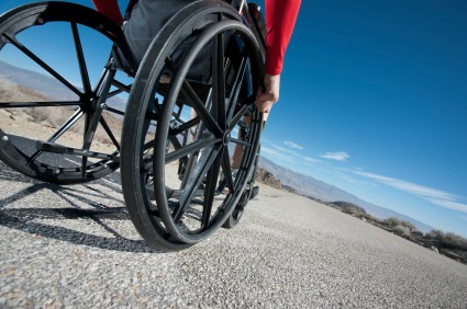 Manual wheelchair with user on smooth road