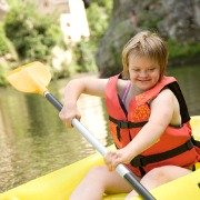 Girl with Downs Syndrome canoeing