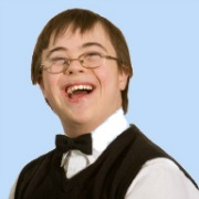 young man with Downs Syndrome dressed in waistcoat and bowtie